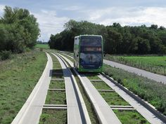 ride the world's longest guided bus-way. It starts in the outskirts of St Ives and travels to the outskirts of Cambridge. Transport Map, Public Transport, Future Concept Cars, Eco City, Cambridge Uk, Bus Coach, Light Rail, St Ives, Busses