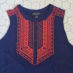 Forever 21 // Embroidered Sleeveless Top - navy Lightweight sleeveless top from Forever 21. Red embroidery on the chest and v-neckline with a navy fabric. Tie backs to add a fitted waist. Previously loved, but in excellent condition. I haven't worn this because it is too big for me. Forever 21 Tops Blouses