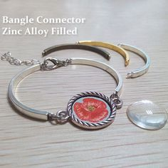 The picture shows a bracelet made with two bangle pieces (available in gold or silver tone or black) and an oval-shaped metal jump ring. In the middle is a bracelet connector with an 18 mm round bezel. You can trade that for other embellishments, such as gemstone bezel, or framed glass jewels. This makes for a versatile and elegant piece of jewelry.