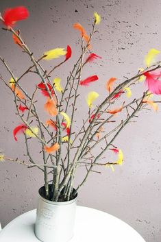 7. Tie some feathers to twigs for perky seasonal decoration. | Make 33 Pretty Things With (Cruelty-Free) Feathers