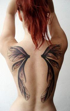 Fairy angel wing on back Female tattoo