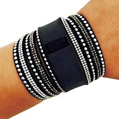 This beautiful silver rhinestone studded Fitbit bracelet is an amazing addition to your Fitbit Charge tracker! The black and white rhinestones add just enough color and accent to t