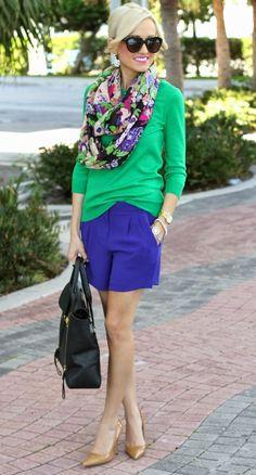 Shop this look on Lookastic:  http://lookastic.com/women/looks/sunglasses-earrings-scarf-long-sleeve-t-shirt-watch-bracelet-shorts-tote-bag-pumps/8129  — Black Sunglasses  — White Earrings  — Green Floral Scarf  — Green Long Sleeve T-shirt  — Gold Watch  — Gold Bracelet  — Blue Shorts  — Black Leather Tote Bag  — Tan Leather Pumps