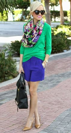 Shop this look on Lookastic:  http://lookastic.com/women/looks/sunglasses-earrings-scarf-long-sleeve-t-shirt-watch-bracelet-shorts-tote-bag-pumps/8129  — Black Sunglasses  — White Earrings  — Green Floral Scarf  — Green Long Sleeve T-shirt  — Gold Watch  — Gold Bracelet  — Blue Shorts  — Black Leather Tote Bag  — Tan Leather Pumps