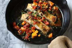 This broiled striped bass recipe is a super simple weeknight fish to whip up. It's packed with Provencal flavor with tomatoes, olives, garlic and capers.
