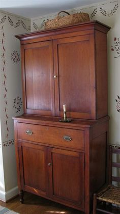 Beautiful Cupboard - not sure how old but does remind me of a Bob Timberlake design from about 10-15 years ago.  Beautiful!