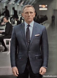 Daniel Craig filming SPECTRE in navy blue sharkskin TOM FORD O'Connor suit. Image enhanced by Matt Spaiser @The Suits of James Bond to correct unsightly areas. Light blue semispread collar French cuff shirt w/white pocket square and silk navy tie by TF.