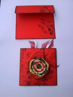 Central flower is made from scraps of all kinds of paper, and entire card was altered with black ink.