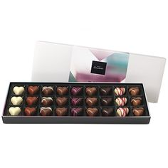 The Valentine's Day Sleekster - Fall head-over-heels for the ever-popular Passion Fruit Truffle, the classically divine Praline Heart and the nutty Amaretto Almond Kiss.