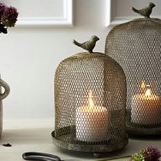 Cloche with candles. Nice for a patio, deck or any garden setting