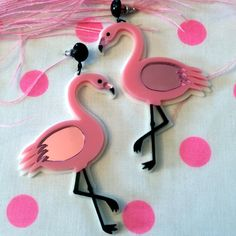 You can literally never go wrong with pink flamingos. The lawn ornaments, the movie, and now, these earrings.  I designed the pendants on my