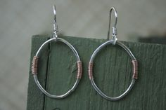 Mixed metal handmade silver and copper earrings from Lake Effect Studios.  https://www.etsy.com/shop/LakeEffectStudios