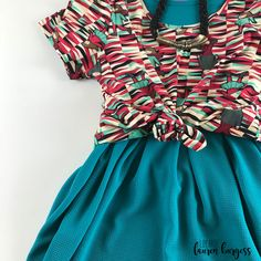 Kids ice skating and sledding are perfect nods to the holiday season, like on this LuLaRoe Holiday Collection Classic scoop neck Tee. Knot it over your favorite LuLaRoe Amelia dress (with pleats and pockets!) for a fun twist on a Christmas look. Click for more! // facebook: LuLaRoe Lauren Burgess Lularoe Amelia Dress, Ice Skating, Knot, Holiday, Christmas, Scoop Neck, Style Inspiration, Pockets, Boutique