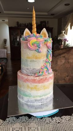 naked pastel rainbow unicorn cake ✨. something sweet by Letty Garcia .