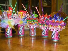 Great for a kid's party....Soda can candy bouquets. Stick the straw directly in the foam first. Then just glue a styrofoam ball to the top of the can (a full can is better to make it bottom heavy) and add candy and decor with T-pins. kp/