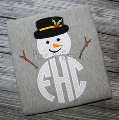 This adorable snowman topper is ready for your favorite monogram. The great thing about snowmen is that they can be worn all winter long through
