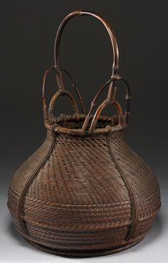 Sozen-style ikebana basket with bands of alternating weave. Chikuunsai I signature. Taisho Period.