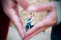 Divine Image Photography - husband and wifes hand make a heart over their kids. Cute family photo idea! :)