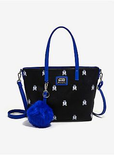 <div>R2-D2 is such a helpful droid, he's giving you a fashionable place to store all of your daily necessities. What a pal! This black faux leather texturized tote bag from <i>Star Wars</i> and Loungefly features an allover debossed R2-D2 print with contrasting blue faux leather handles, optional removable and adjustable crossbody strap and on-trend blue fuzzy pom charm key chain. Inside the magnetic snap closure are two compartments separated by a zipper closure pouch in the center, with…