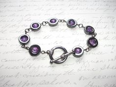 Modern bracelet made of beautiful hematite stone rings with purple firepolish faceted glass beads finished with a toggle clasp. long See also matching earrings in my store. Ring Bracelet, Bracelets, Boutique, Etsy, Jewelry, Handmade Gifts, Unique Jewelry, Hands, Schmuck