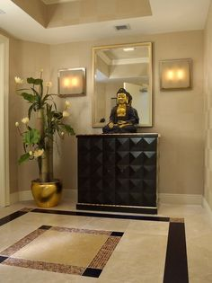 Elegant entry decorated with gold accents and a Buddha statue
