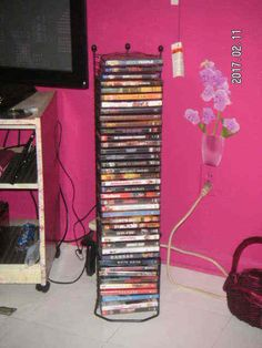 Looking for a Floor TOWER for your BLU-RAY & DVD Video Movies? Here is a  BLACK METAL Media RACK that holds 40 DVD & BLU-RAY Movie Disc CASES [MsFrugaLady on eBay, storage organizer]