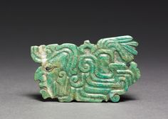 Greenstone ornament, Maya style ca. 250-900 AD, The Cleveland Museum of Art
