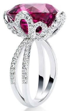 I would love to have my grandmother's ruby reset like this!
