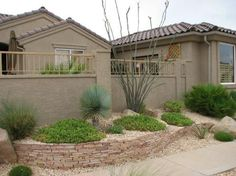 A desert southwest landscaped front yard corner lot. With Ocotillo on south west design ideas, south west yard fence ideas, southwest courtyard ideas,