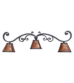 Hand forged iron vanity light with mica shades. Part of our 2017 collection from www.haciendalights.com