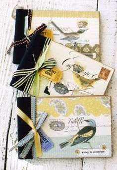 photo book with assorted bird collages holds 20 photos embellished with cotton twill.  By Anna Corba