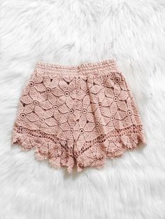These crochet shorts feature full lining, a high waist and scalloped hemline. Fabric Content: 98% POLYESTER 8% SPANDEX