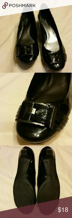 Nine West Patent Leather Flats Black patent leather low heeled shoes size 9.5. Black buckle accent on toe. Only worn three times. One mark on right shoe shown in last photo. Nine West Shoes Flats & Loafers