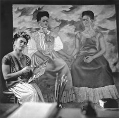 Frida painting The Two Fridas, Coyoacán, 1939