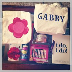 Flower girl gift bags. Includes: personalized tote, coloring book, princess crayons, bracelets, bubbles, and flower hair pin.