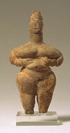#statue, #woman, #goddess, #standing, #hair, #face, #hands under #breasts, #navel, #steatopygous #belly, #hips, #buttocks, #legs, #terracotta. #6000BCE - #5000BCE. #Greece.