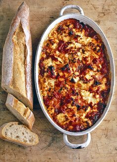 Feta baked with tomato and oregano