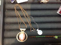 This simple necklace with peach stone accent is a great way to add color to your outfit without going too bold.  One sale as of 6/18/14 for only $2.00 at the Carousel Shop at 23 Calendar Ave. La Grange, IL.  All proceeds go directly to benefit Community Nurse Health Center.