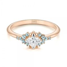 This gorgeous rose gold engagement ring features a princess cut diamond and delicate aquamarine gemstones to accent the center. Ring designed and created by Joseph Jewelry   Bellevue   Seattle   Online   Design Your Own Engagement Ring