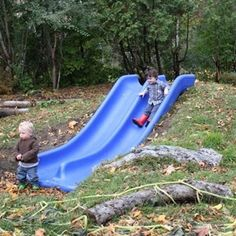 Build your slide into the hillside. It's a lot safer! This would totally work in our backyard! What a fun idea!