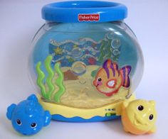 The wiggles vintage racing to the rainbow backpack greg for Fisher price fish bowl