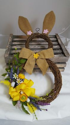Cute Easter bunny wreath with artificial flower decoration
