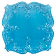 "Ceramic dinner plate with scrolling detail.  Product: Dinner plateConstruction Material: CeramicColor: TurquoiseFeatures: Scroll motifDimensions: 1.25"" H x 10.5"" W x 10.5"" D Cleaning and Care: Dishwasher safe"