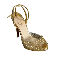 Christian LOUBOUTIN Stunning gold leather and spikes evening sandals size 37 | From a collection of rare vintage shoes at http://www.1stdibs.com/fashion/accessories/shoes/