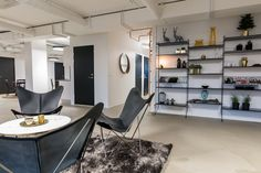 The office is designed to boost social interaction in spaces like the lounge. The seating arangement is comfortable and relaxed and the shelving in the background adds a personal touch to the interior. #officedesign #office #design Ideas » Design Concept Event