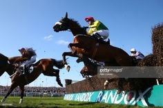 Fox Norton ridden by Robbie Power crashes through a fence on the first time around during the JLT Melling Chase on Ladies Day at Aintree Racecourse on April 7, 2017 in Liverpool, England.
