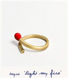 Light my fire ring created by Defy. A gold brass match with a red enamel end. It'll wrap around your finger to light up your look !