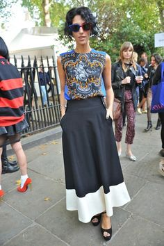 Opposites attract: Yasmin Sewell offsets a colorful print top with a monochrome skirt #LFW
