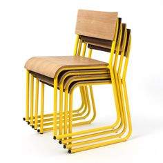 Gus* Modern | The Church Chair will be introduced in Walnut/Canary and Oak Natural/Canary.  This stackable chair design was inspired by the functional seating used in gathering rooms at churches, schools, and public buildings. Features a bent-plywood seat and back with powder-coated metal frame.