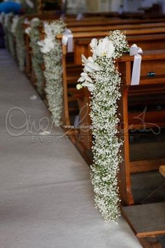 Long drape of baby's breath as the aisle decoration in a wedding ceremony.